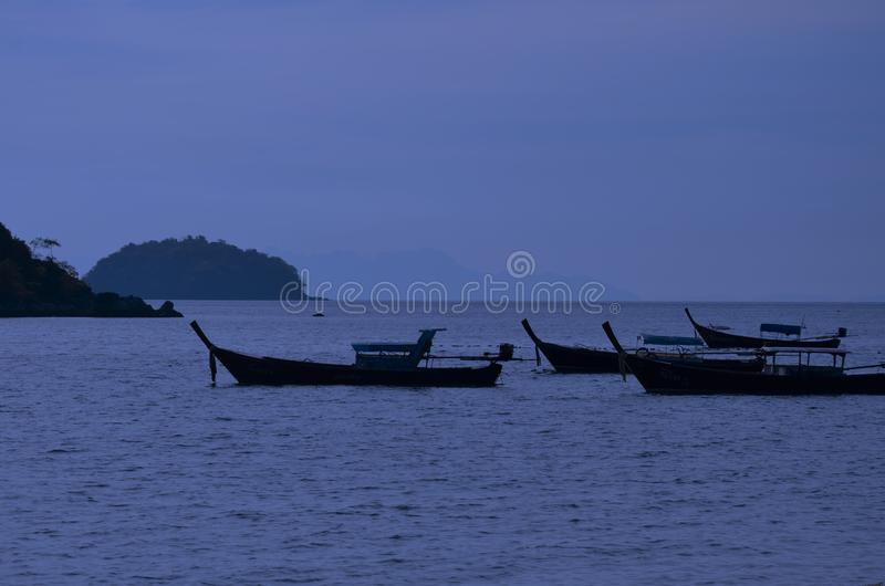 Passenger boats in peace blue sea and night sky. Floated passenger boats in peace blue sea and night sky in Thailand royalty free stock photo