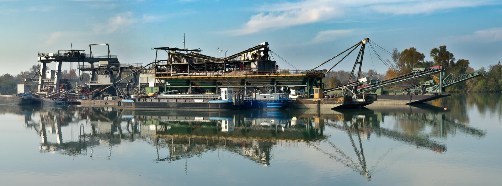 Floater dredge. Stitched Panorama of a floater dredge at rhine river, germany royalty free stock photos