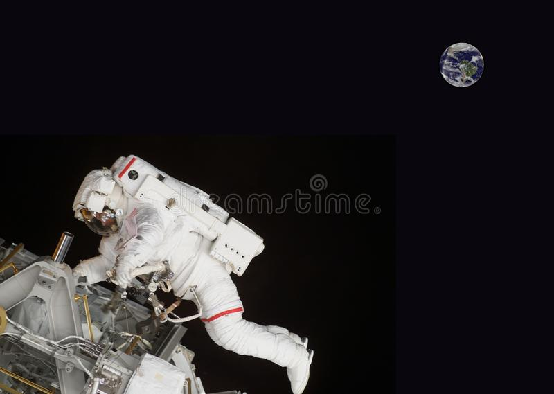Floating astronaut in space composite image some elements courtesy of nasa royalty free stock photo