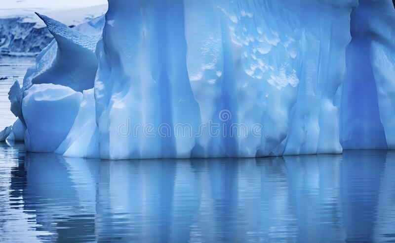 Floating Blue Iceberg Reflection Paradise Bay Skintorp Cove Antarctica stock photo