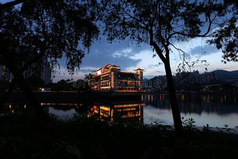 A floating boat Chinese restaurant, resting on a claim river in Shatin Hong Kong. Evening dim light royalty free stock photos