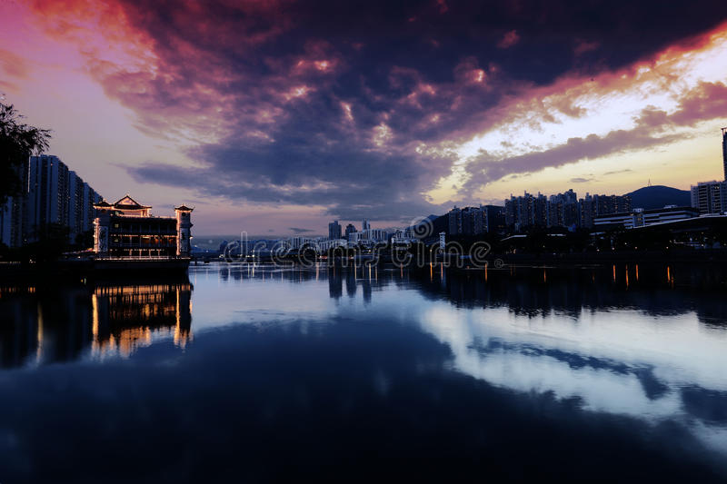 A floating boat Chinese restaurant, resting on a claim river in Shatin Hong Kong. Evening dim light stock photography