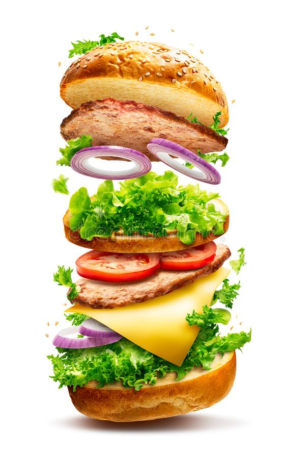 Floating burger isolated. Floating delicious burger with flying ingredients isolated on white background with clipping path royalty free stock photo