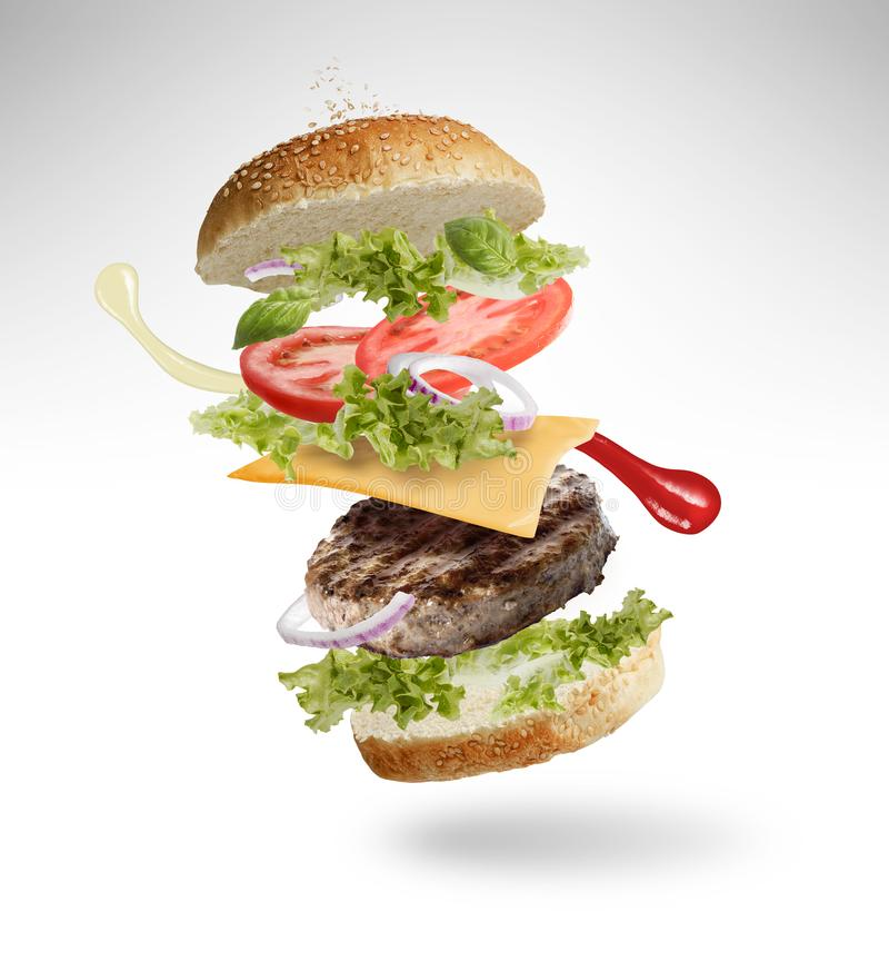 Floating Cheeseburger  royalty free stock photography