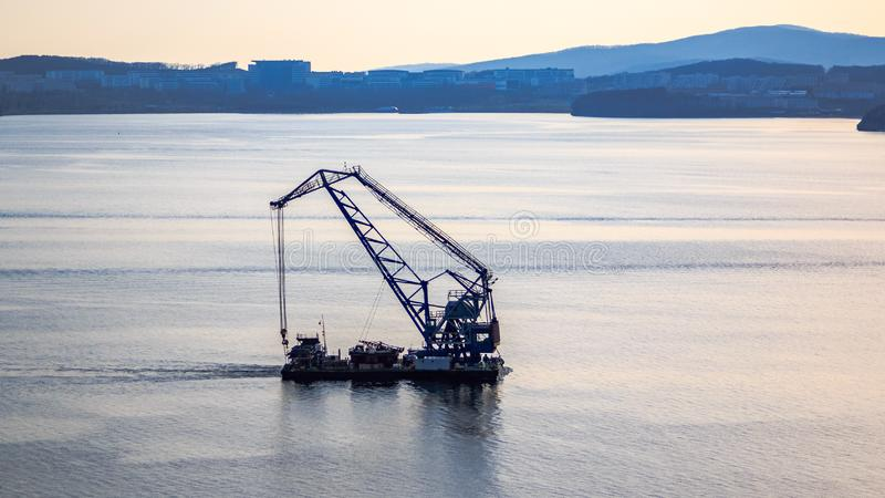 Floating crane on the background of the island Russian sails through the Bosphorus East stock photos