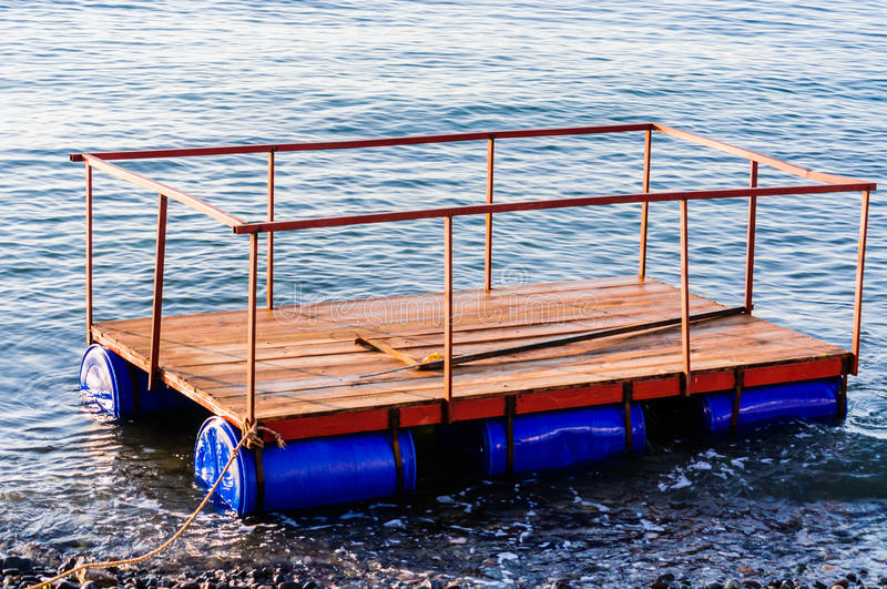 Floating Dock For Construction Purposes. A small floating dock on the shoreline of the Marmara sea for piled dock construction purposes stock images
