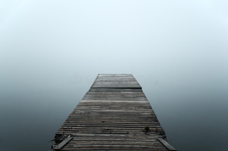 Floating dock in mist stock photos