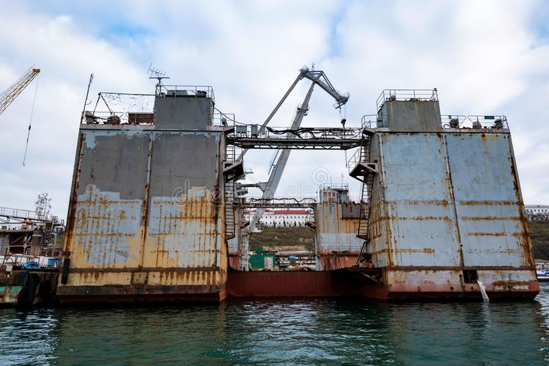 Wiew of floating dock for repairing ships in Black Sea. Floating dock or pontoonfor repairing ships stock photography
