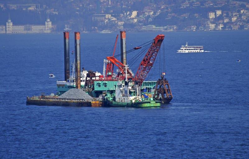 Floating dredging platform in Bosphorus stock image