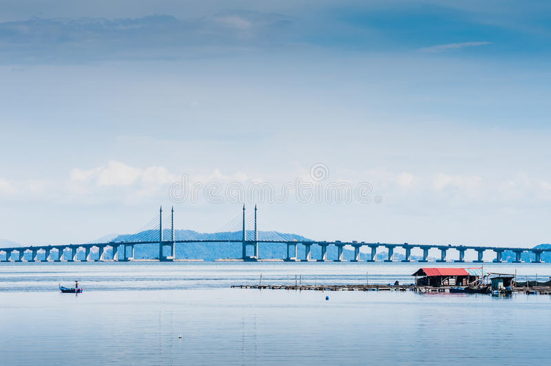 Floating Fish Cage and Penang Bridge. View of floating salt water fish and Penang Bridge stock photography