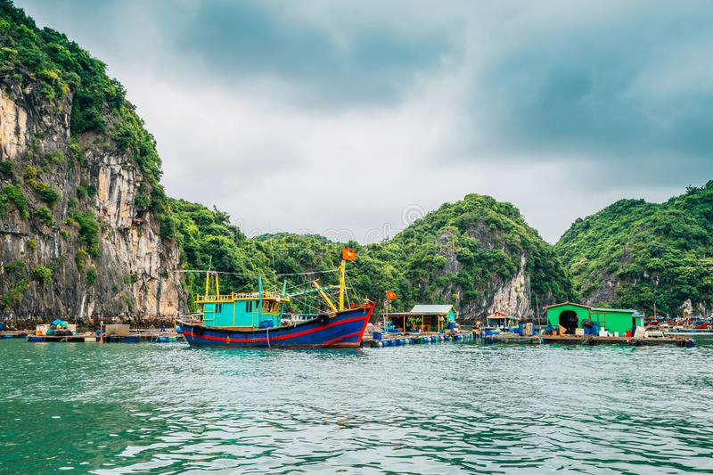 Floating fishing village and rock island at Lan Ha Bay, Ha long Bay tour in Vietnam stock images