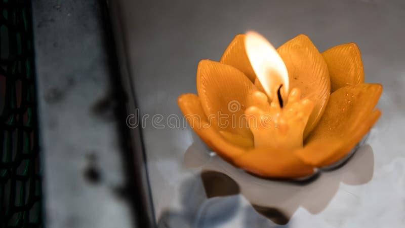 Floating flower candle stock image
