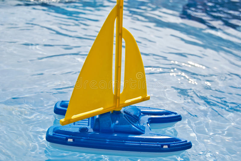 toy sailboat in pool royalty free stock photo