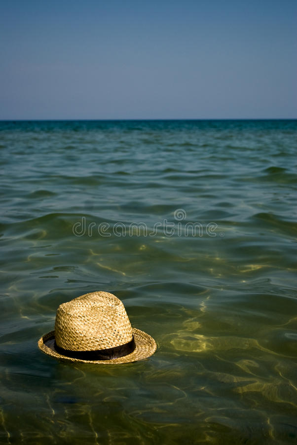 Download Boater Hat Floating On The Water As Holiday Concep Stock Photo - Image: 26600998