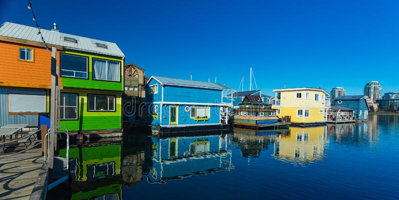 Floating Home Village Houseboats Fisherman`s Wharf Inner Harbor, Victoria British Columbia Canada.Area has floating homes, boats,. Piers, restaurants and royalty free stock photos
