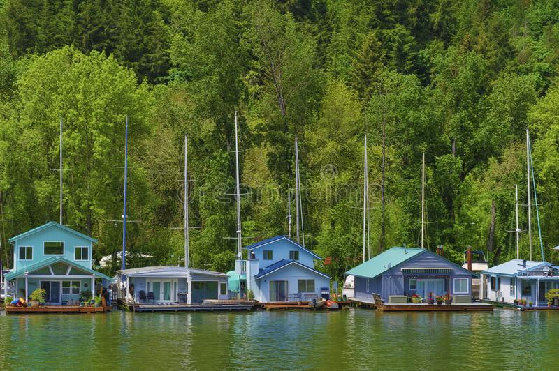 Floating Homes on Portlands Sauvie Island. Sauvie Island, Oregon,USA - May 10, 2018: Floating homes on the Multnomah Channel of the Willamette River near royalty free stock photo