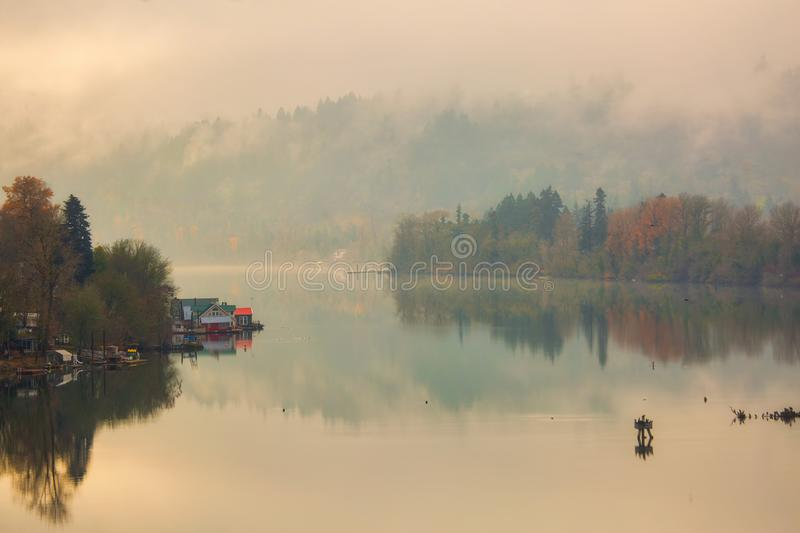 Floating Homes on the Willamette River in Oregon. City during a foggy fall day USA stock photography