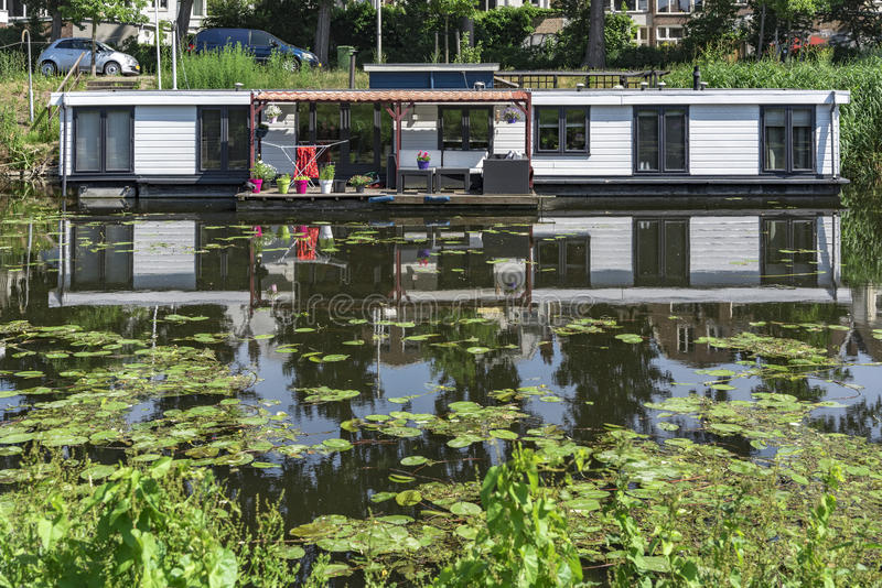 Floating house. Built on the water due to the global warming and the elevation of the water level around the world becomes reality and concept royalty free stock images