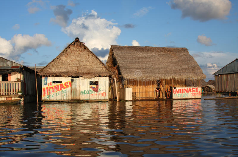 Floating houses on the Amazon River royalty free stock photo