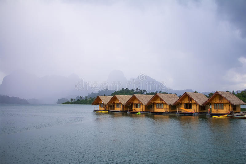 Floating houses on a lake royalty free stock photo