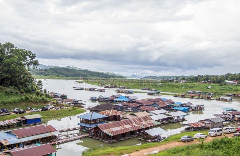 Floating houses near Mon bridgeUttama Nusorn Bridge in Sangkhlaburi district,Kanchanaburi province,Thailand.Thailand's longest w royalty free stock photo