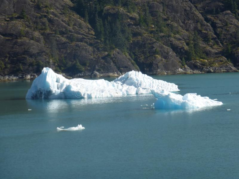 Floating ice berg from glacier in Alaska. Inlet to glacier in Alaska with blue color due to no oxygen in the ice royalty free stock photography