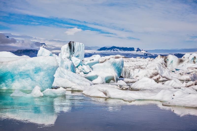 Floating ice and clouds stock images