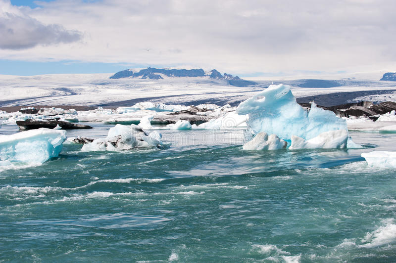 Floating icebergs and view to the glacier, ice lagoon Jokulsarlon, Iceland royalty free stock images