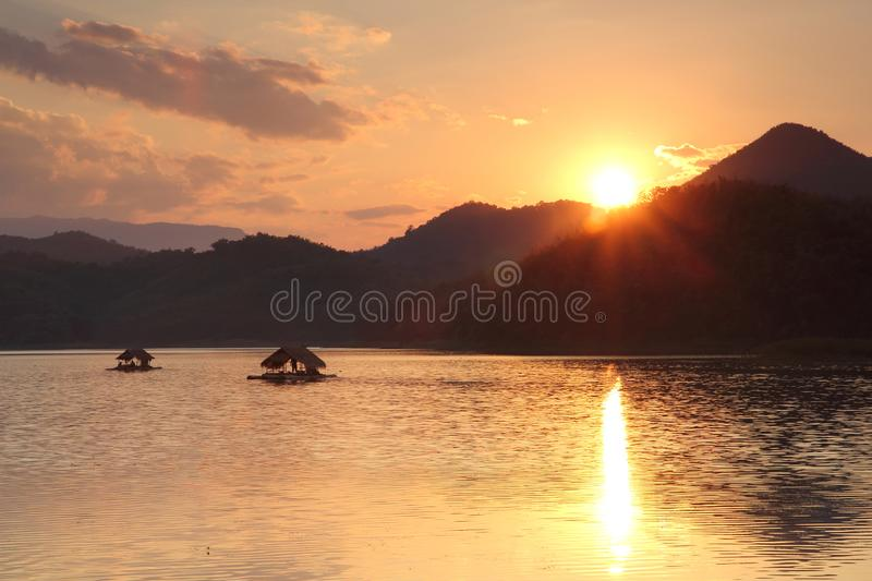 Floating. On the lake for summer vacation, sunset, sail, sailboat, water, blue, adventure, sunlight, holiday, travel, motion, forest, scenic, journey, sky stock photo