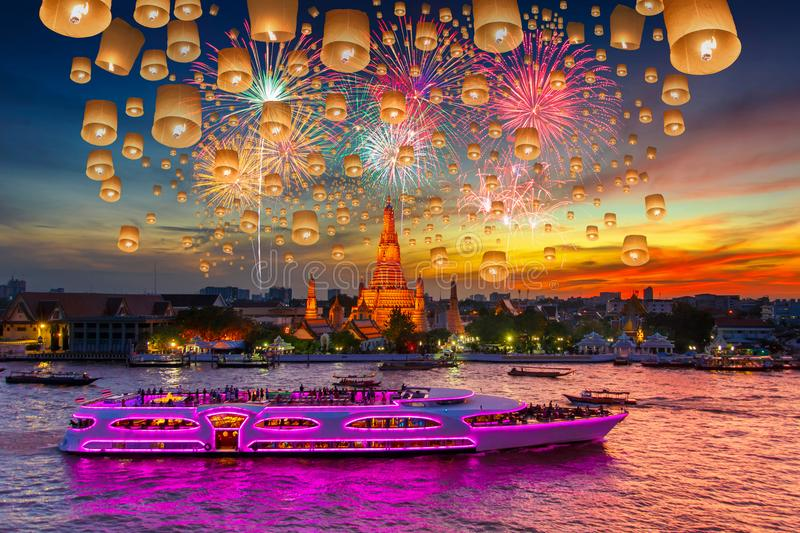 Floating lamp and Fireworks at Wat arun and cruise ship in sunset time under new year celebration stock photography