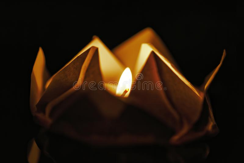 Floating lotus flower on water. Festival paper lanterns at night. Close up and shallow depth of field. stock photography