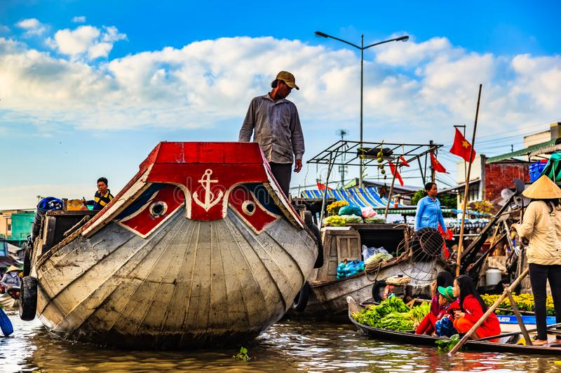 Floating market in Mekong River, Vietnam. Mekong River, South of Vietnam. Tam Ban, Sampan, small boat, a traditional popular transportation of the region. Small stock photo