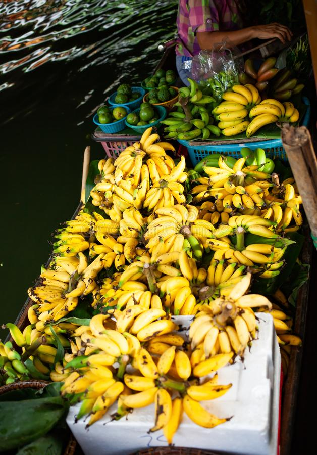 Floating market - top view of boat full of fresh fruits on sale. Thailand, travel, water, river, bangkok, food, people, tourist, tradition, tourism, trade stock images