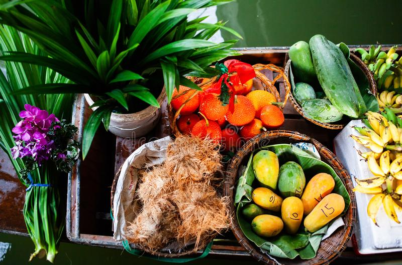 Floating market - top view of boat full of fresh fruits on sale. Thailand, travel, water, river, bangkok, food, people, tourist, tradition, tourism, trade stock image