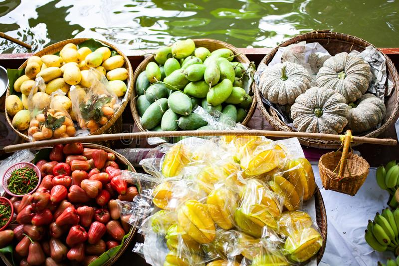 Floating market - top view of boat full of fresh fruits on sale. Thailand, travel, water, river, bangkok, food, people, tourist, tradition, tourism, trade royalty free stock photography