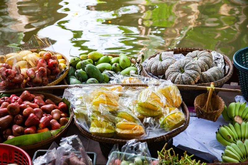 Floating market - top view of boat full of fresh fruits on sale. Thailand, travel, water, river, bangkok, food, people, tourist, tradition, tourism, trade royalty free stock photos