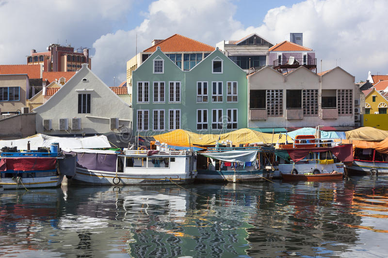 Floating market in Willemstad. Colorful floating fruit market in Willemstad on Curacao royalty free stock photos
