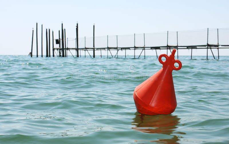 Floating orange buoy royalty free stock photography