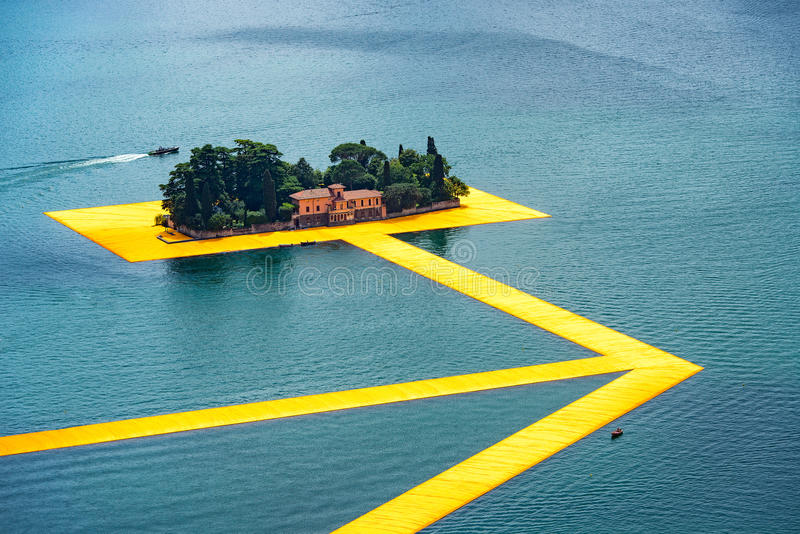 The floating piers. The artist Christo walkway on Lake Iseo St.Paul island. royalty free stock photo