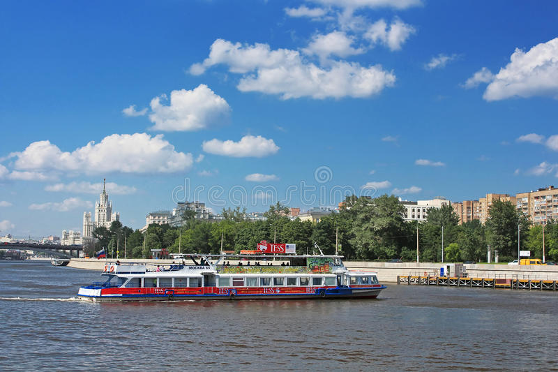 Floating pleasure boat with people in Moscow, Russia royalty free stock images