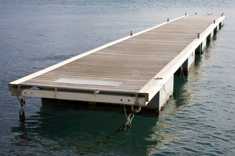 Floating pontoon. Anchored on calm sea royalty free stock images