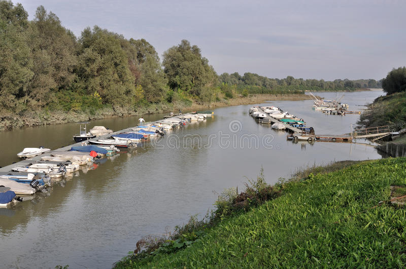 Floating quays, po river. Floating quays of harbour on a lateral ramification of po river, in emilia near parma royalty free stock photo