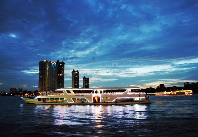 The floating restaurant dinner cruise, Thailand. The floating restaurant dinner cruise, Bangkok Thailand. The beautiful scenery of river at night time stock image