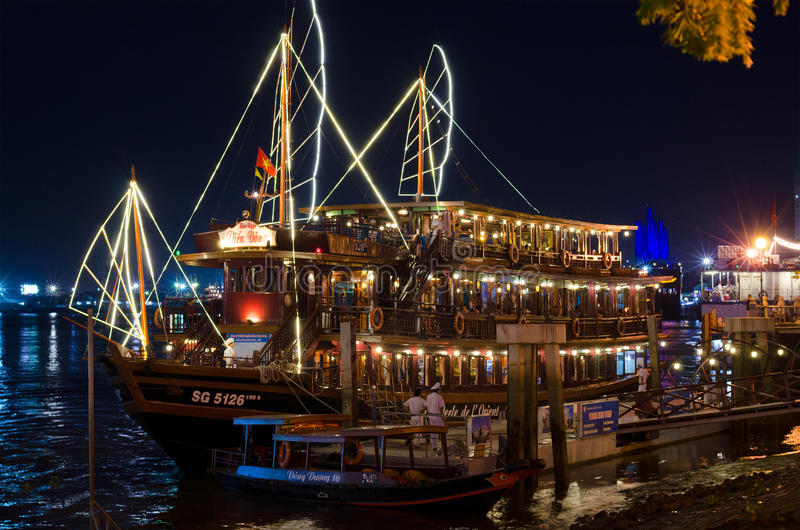 Floating restaurant, Saigon river. HO CHI MINH, VIETNAM - JULY 10, 2014: Unidentified people gather to have dinner at the Le Perle de lOrient floating restaurant royalty free stock photo