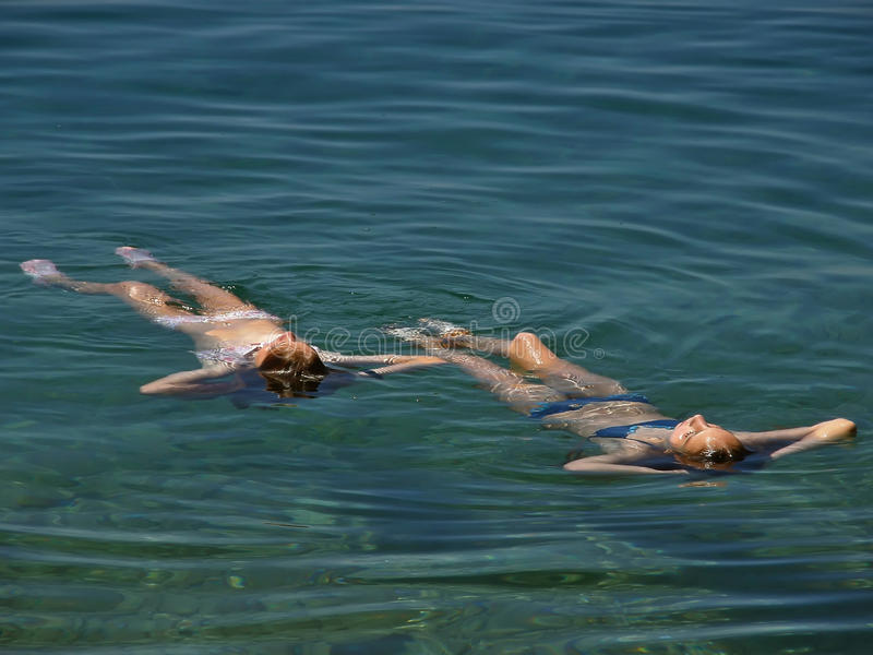 Floating at sea stock photography