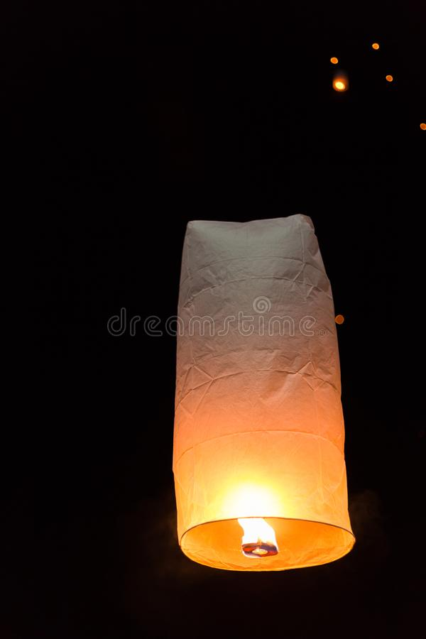 Floating sky lanterns during Loy Kratong Festival in Nan, Thailand royalty free stock photography