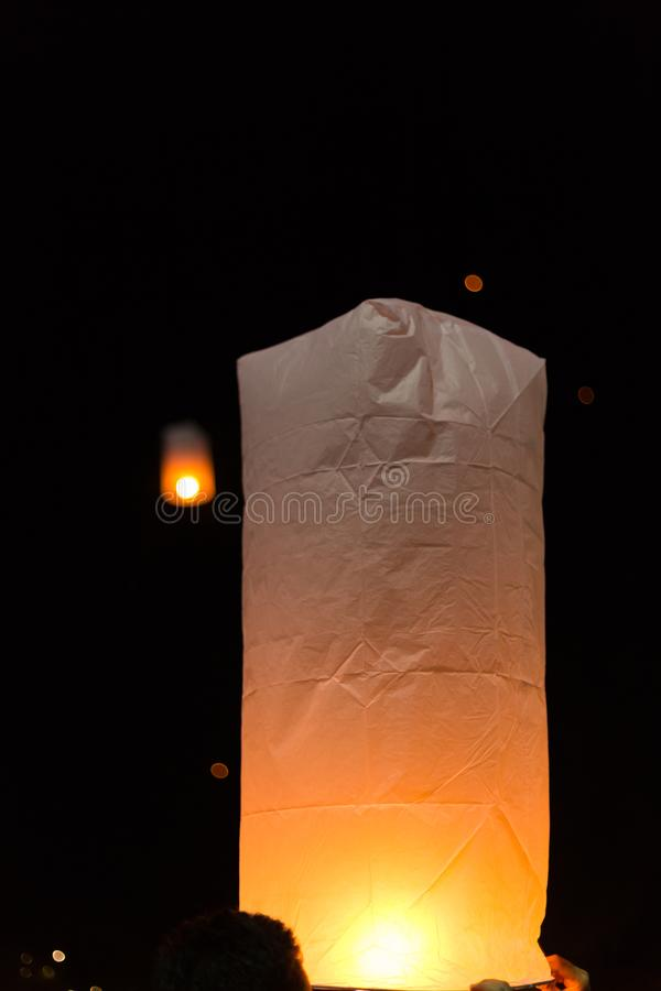Floating sky lanterns during Loy Kratong Festival in Nan, Thailand royalty free stock photo