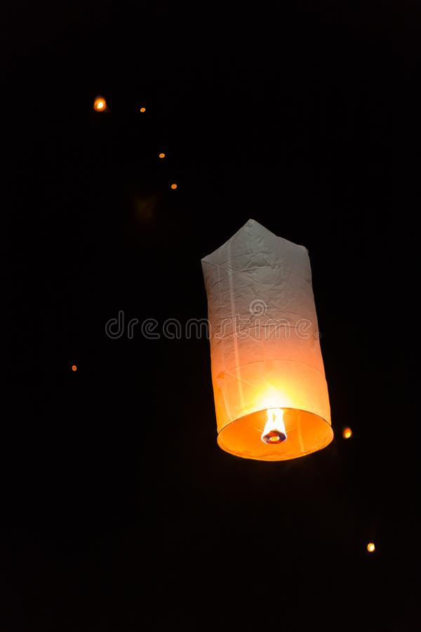 Floating sky lanterns during Loy Kratong Festival in Nan, Thailand royalty free stock image