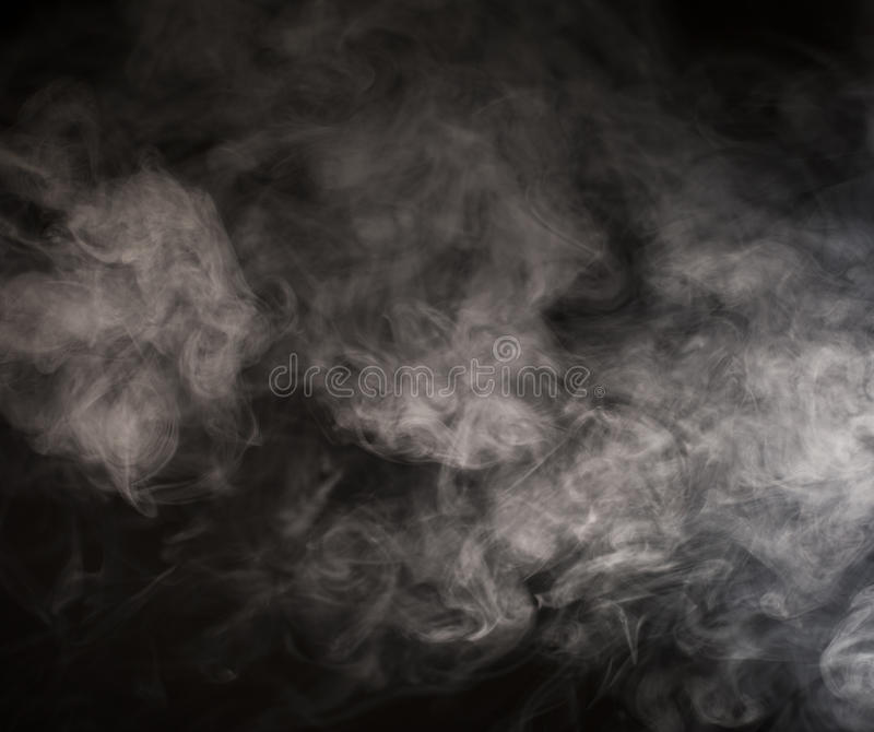 Floating smoke. Smoke floating on black background stock image