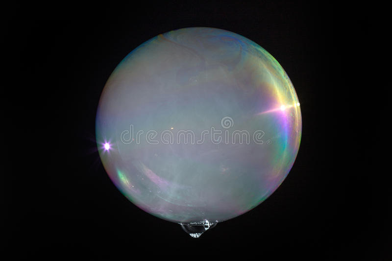 Floating soap bubble filled with smoke. Isolated on a black background stock photos